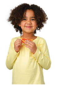 Child holding an orange slice