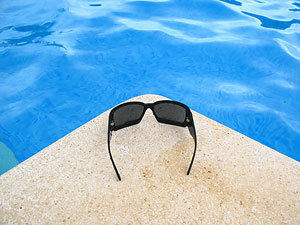 Sunglasses next to pool